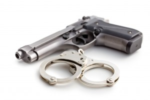 gun and handcuffs